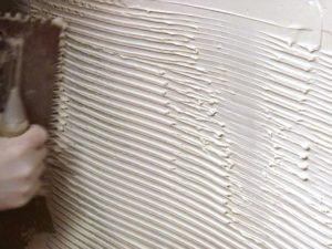 Как положить декоративного камень стену
